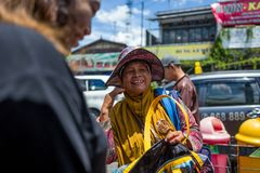 Yogyakarta, Indonesia - March 16, 2018: Smiling woman selling bags on Malioboro Road in Yogyakarta. Yogyakarta, Indonesia - March 16, 2018: Smiling woman Stock Photos