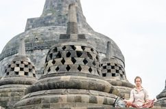 Yogyakarta, Indonesia - May 20, 2016 - Meditation and praying ancient Buddha statue at Borobudur temple in Yogyakarta, Java, Indon Stock Photography