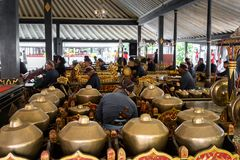 Musicians perfoming Gamelan music at King`s palace in Yogyakarta, Indonesia. Yogyakarta, Indonesia - October 2017: Musicians perfoming Gamelan music at King`s stock photography