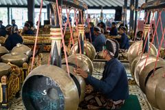 Musicians perfoming Gamelan music at King`s palace in Yogyakarta, Indonesia. Yogyakarta, Indonesia - October 2017: Musicians perfoming Gamelan music at King`s Stock Images