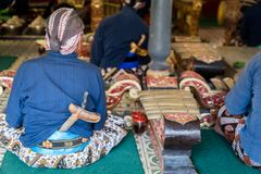 Musicians perfoming Gamelan music at King`s palace in Yogyakarta, Indonesia. Yogyakarta, Indonesia - October 2017: Musicians perfoming Gamelan music at King`s Stock Photos