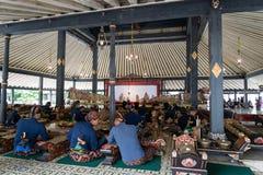 Musicians performing Gamelan music and Wayang, shadow puppet show, at King`s palace. Yogyakarta, Indonesia - October 2017: Musicians performing Gamelan music Stock Photos