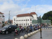 Yogyakarta city landmark. Yogyakarta, Indonesia - October 31, 2018: Traffic at Kawasan Titik Nol kilometer zero point with the background of Dutch colonial old stock image
