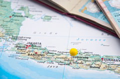 Yogyakarta, Java, Indonesia, Yellow Pin and Passport, Close-Up o. Macro of Yellow Pin, Yogyakarta, Java, Indonesia, Passport, Close-Up of Map stock image