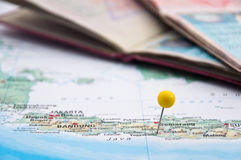 Yogyakarta, Java, Indonesia, Yellow Pin and Passport, Close-Up o. Macro of Yellow Pin on Map, Yogyakarta, Java, Indonesia, Yellow Pin and Passport, Close-Up of stock photos