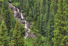 Yoho National Park. Typical waterfall you might see in Yoho National Park in British Columbia Canada. The rugged Rocky Mountains are all around you as you drive Stock Image