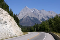 Yoho National Park. Road and Rocky Mountains Royalty Free Stock Image