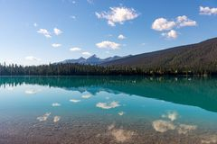Clouds reflected in the beautiful waters of Emerald Lake in Canada`s Yoho National Park. stock photos