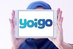 Yoigo telecommunications company logo. Logo of Yoigo telecommunications company on samsung tablet holded by arab muslim woman. Yoigo is the fourth largest mobile Stock Photography