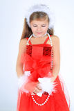 A yoing girl with christmas present smiling Royalty Free Stock Photos