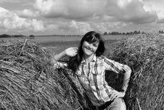 Yoing woman in haystacks on fields Stock Photo