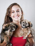 Yoing woman holding two puppies Stock Photo