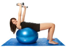 Yoing women doing weight training Royalty Free Stock Photography
