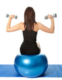 Yoing women doing weight training Royalty Free Stock Images