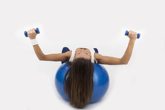 Yoing women doing weight training Royalty Free Stock Image