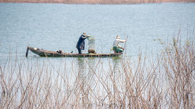 Yokefellow fishermen on the lake in DucTrong- LamDong- VietNam Royalty Free Stock Image