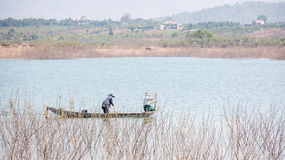 Yokefellow fishermen on the lake in DucTrong- LamDong- VietNam Royalty Free Stock Photography