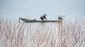 Yokefellow fishermen on the lake in DucTrong- LamDong- VietNam Royalty Free Stock Photos