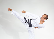 Yoko geri beats sportsman with black belt Stock Photography