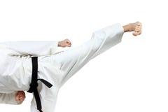 Yoko-geri in perfoming an athlete in karategi. On the white background Stock Image