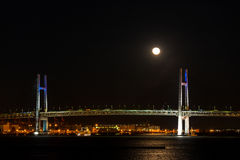 Yokohama bay bridge with full moon Stock Image