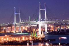Yokohama Bay Bridge at Night. Yokohama Bay Bridge & surrounding busy port area in Japan Royalty Free Stock Images