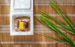 YOKOHAMA, JAPAN - DECEMBER 15: Commercially packaged traditional. Japanese fermented beans with sauce packets and raw green onions on a bamboo mat Stock Image