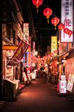 Restaurant street - illuminated small alley with red Chinese lan royalty free stock image