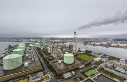 Yokohama LNG Town Gas Supplier in a rainy day. YOKOHAMA, JAPAN - Apr 07, 2016: View from the roof of Yokohama Isogo thermal power plant on the LNG Town Gas Royalty Free Stock Image