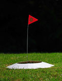 Yolf hole and flag Royalty Free Stock Photo