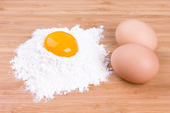 Yolk of egg of house hens and wheat flour Stock Photos