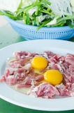 Yolk egg and raw meat. Raw meat and  fresh sliced pork , yolk egg  prepare for cooking Stock Photo
