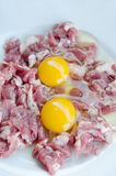 Yolk egg and raw meat. Raw meat and  fresh sliced pork , yolk egg  prepare for cooking Royalty Free Stock Photos
