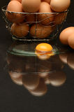 Yolk egg. On reflection mirror with black background stock photos