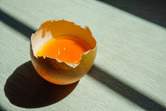 Yolk in egg shell Royalty Free Stock Photos