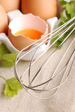 Yolk of egg with whisk Royalty Free Stock Photography