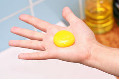 Yolk in hand Stock Photo