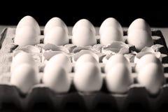 Yolk among many white eggs Royalty Free Stock Images