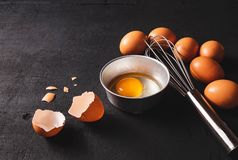 Yolks and egg protein in a cup. Corolla whisk eggs. Preparation royalty free stock image