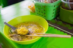 Yollow asina style noodle call ba mee with meat ball on spoon an Royalty Free Stock Image
