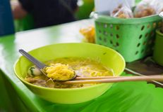 Yollow asina style noodle call ba mee with meat ball on spoon an Stock Photography