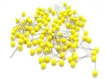 Yollow sewing pins Royalty Free Stock Images