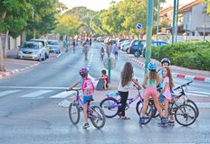 Yom Kippur in Tel Aviv, Israel. TEL AVIV - OCT. 4, 2014: People walking and riding in the streets on Yom Kippur (Day of Atonement) in Tel Aviv.  There is little Royalty Free Stock Photos