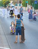 Yom Kippur in Tel Aviv, Israel. TEL AVIV - OCT. 4, 2014: People walking and riding in the streets on Yom Kippur (Day of Atonement) in Tel Aviv.  There is little Stock Photo