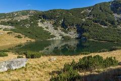 Yonchevo lake and green hills,  Rila Mountain Stock Photo