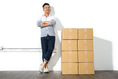 A yong asian man with boxes move house Royalty Free Stock Images