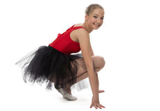 Yong ballerina sitting on haunches Stock Images