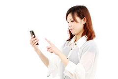 Yong business woman with mobile phone Royalty Free Stock Photos