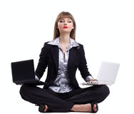 Yong business woman in yoga with two laptop Royalty Free Stock Image