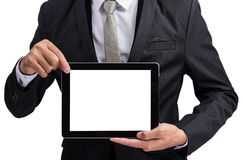 Yong businessman holding digital tablet computer showing screen Royalty Free Stock Photo